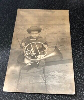 Early Rppc - Small Child In Chair With French Horn
