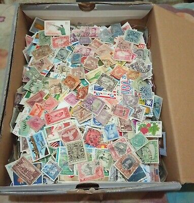 20000+ of unchecked unsorted worldwide stamps in box as received.
