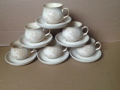 A set of 6 Denby stoneware Maplewood tea cups and saucers