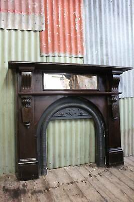 An Art Nouveau  Fireplace Mantle Surround with Mirror