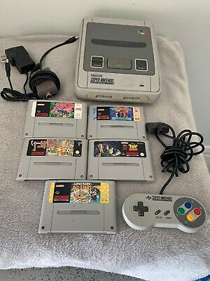 Super Nintendo Game Console Complete With 5 Games
