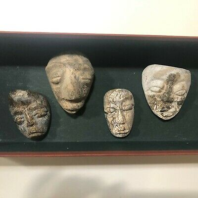 Rare Hand Carved Faces  Masks in Petrified Wood or Stone Set of 4 Unknown origin