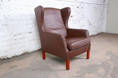 Fantastic Brown Leather Wingback Chair With Head To Head Nails Caraccident5 Cool Chair Designs And Ideas Caraccident5Info