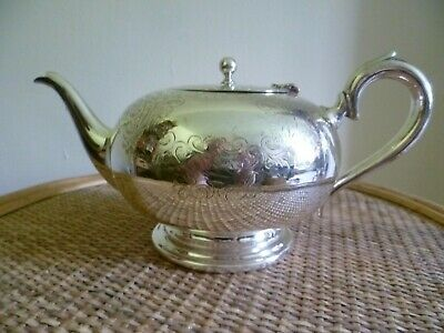 AN ANTIQUE ORNATE CHASED FLORIATE PATTERN SILVER PLATED TEAPOT. By 'C S G & Co'