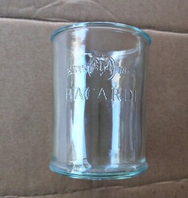 Drinking glass made from old Bacardi rum bottle with bat logo