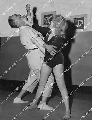 crp-2324 1957 Marilyn Monroe look-alike Toni West judo instructor after mauling