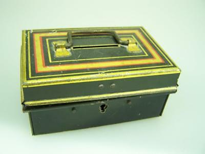 Vintage Made in England money box with collection of keys and padlocks contents