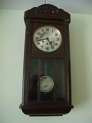 Wall Chiming Antique clock with pendulum