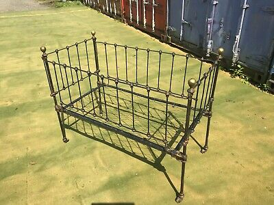 Victorian iron and brass child's cot bed.