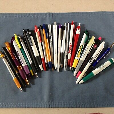 An assortment of 24 drug rep and other pens, none write