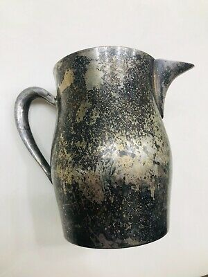 Silver on copper pitcher