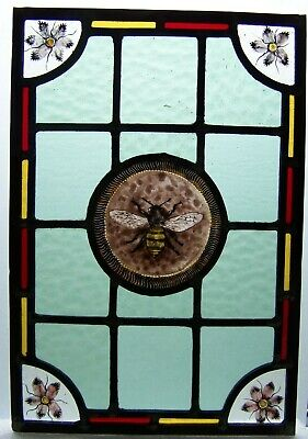 Victorian style stained glass panel with bee.