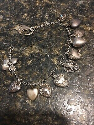 Vintage sterling puffy heart charm bracelet:  11 Miniature Hearts And Padlock
