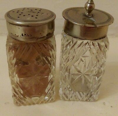 Two glass condiment pots with EPNS tops