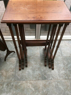 Edwardian nest of three tables in fruit wood - with cross banding on the tops