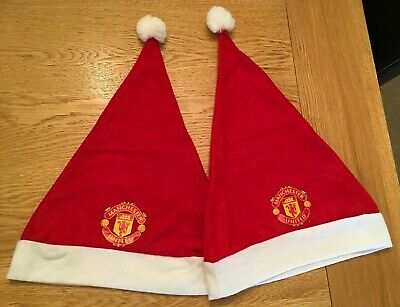 2 x MANCHESTER UNITED CHRISTMAS HAT IN RED. UNUSED,