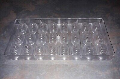 Clear polycarbonate chocolate mould with 24 oval ripple cavities
