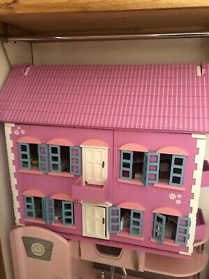 Pink Wooden dolls house - as new