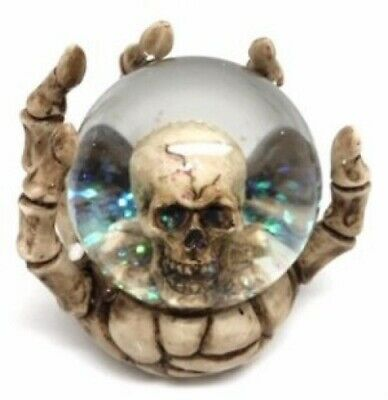 Skeleton Hand Holding Glass Snow Globe Waterball with Glitter Snow and Skull