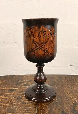 A 17th century English yew wine cup.