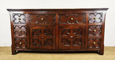 A handsome 17th century style dresser base.