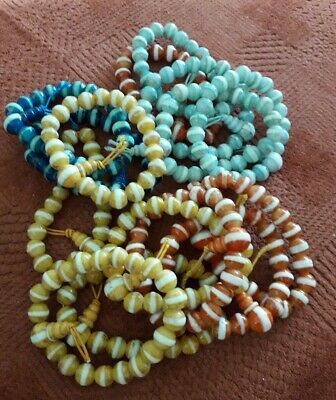 Craft clear out:  14 beaded bracelets, various colours