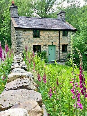 Old world riverbank traditional Welsh cottage Betws Y Coed, Snowdonia N. Wales