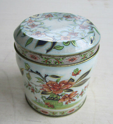 """Pretty cylindrical tin with flower design - 3 7/8"""" tall"""