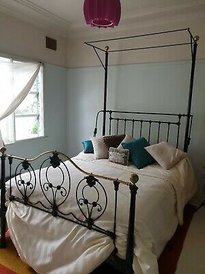 Cast Iron double bed, black powder coated, brass features.