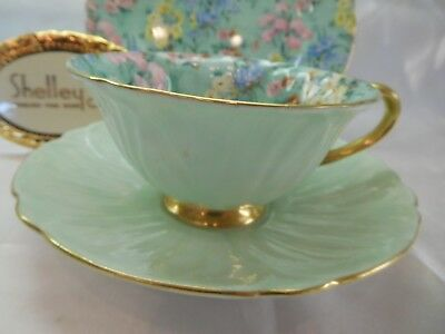 "Shelley MELODY CHINTZ  FOOTED OLEANDER  CUP, SAUCER AND 7"" PLATE  -  GOLD TRIM"