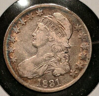 1831 CAPPED BUST SILVER HALF DOLLAR VF or better with nice toning.