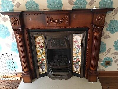 reproduction Victorian-style fireplace with cast iron insert hearth.