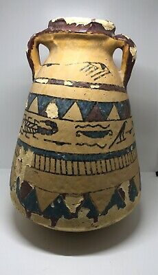 An Egyptian two handled painted pottery jar with hieroglyphic decoration