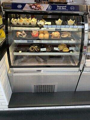 illuminated used retail glass display cabinets, very good condition.