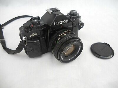 Canon A-1 35mm SLR Film Camera - 3 lenses, flash and case.