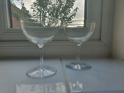 A pair of small Victorian Delicate Crystal Champagne saucers
