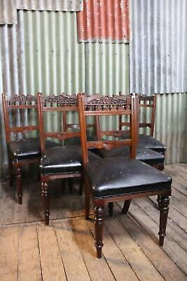 A Set of Six Walnut Art Nouveau Dining Chairs
