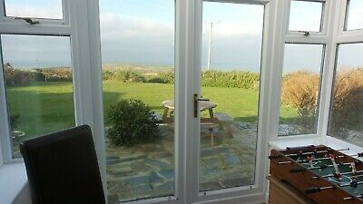 Dog friendly holiday cottage Anglesey log fire sea views sleeps 8 4th Nov 3 nts
