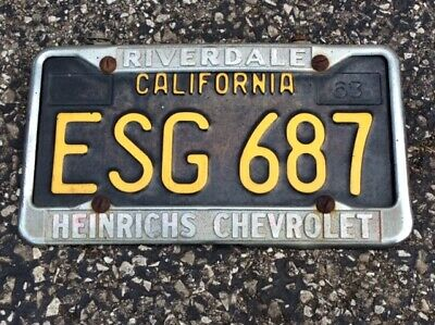 HEINRICHS CHEVROLET in RIVERDALE FRAME with a CALIFORNIA LICENSE PLATE TAG 1963