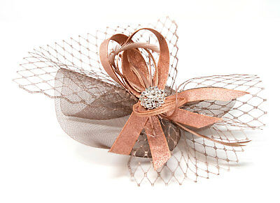 Metallic rose gold fascinator with diamantè and bead cluster on an alice band