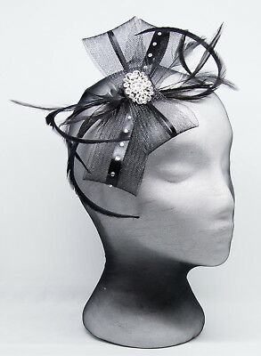 Black fascinator with a sparkling diamante' brooch on a comb, Alice band or clip