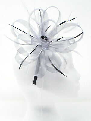 New big silver and black fascinator on a comb.
