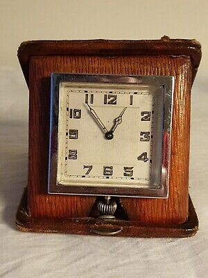antique Swiss Chrome travel clock in Leather Case Circa 1930