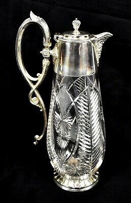A late 19th/early 20th century silver plated mounted claret jug.