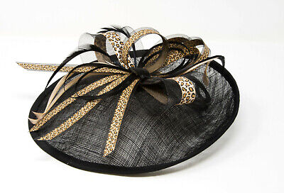 Black and leopard print hatinator style fascinator with comb, clip, alice band.