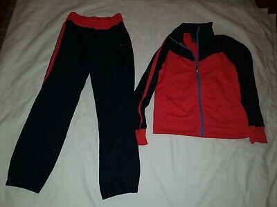 Navy And Orange Nike Girls Tracksuit Age 10-11 Yrs. Excellent condition.