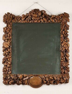 After Grinling Gibbons - A Fine 18th century walnut Mirror.