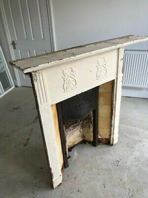 Victorian / antique cast iron fire surround with tile inserts and back plate