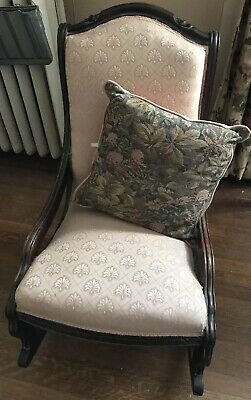 Antique cushioned rocking chair