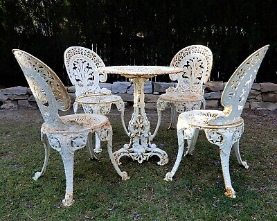 Antique white CAST IRON garden setting table and 4 chairs made in England 1930's